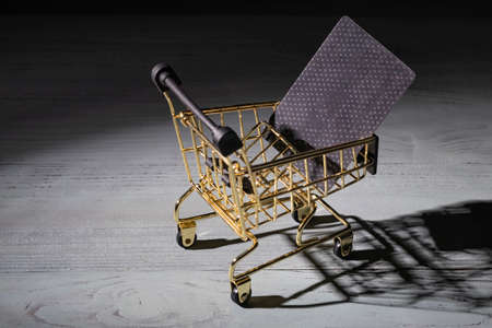 studio lighting. light in the dark is applied to a yellow metal trolley. Close-up Фото со стока