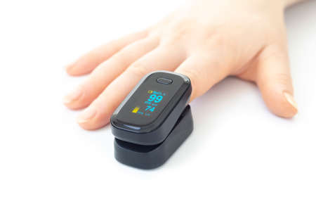 Portable black pulse oximeter on a white background. Monitoring the oxygen level at home.