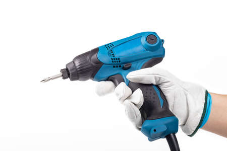 studio lighting. the human hand in it is an electric impact screwdriver. On a white background. Close-up Banco de Imagens