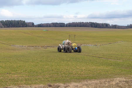 Street lighting. special machine on wheels for gentle spraying of crops in the field. Filled with fertilizer for plants