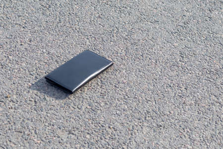 Street lighting. there is a wallet on the road on a sunny summer day. Фото со стока