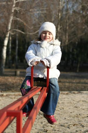 merry child on playground, springtime photo