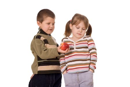naivety: Two children and an apple, on a white background Stock Photo