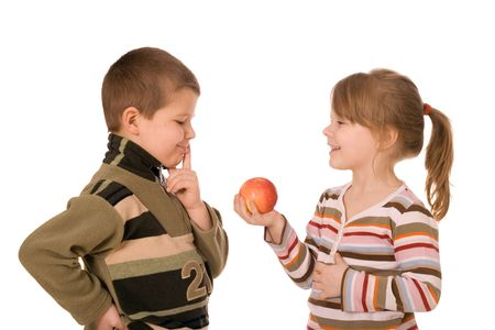 Two children and an apple, on a white background Stock Photo