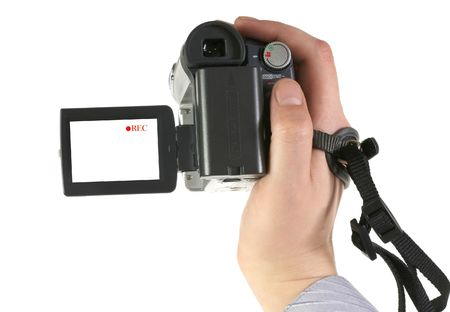 The man holds an amateur digital videocamera Stock Photo