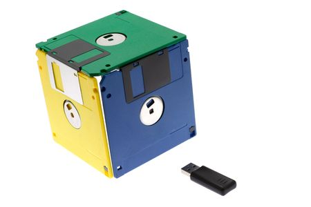 Multi-coloured cube made of old diskettes, on a white background photo