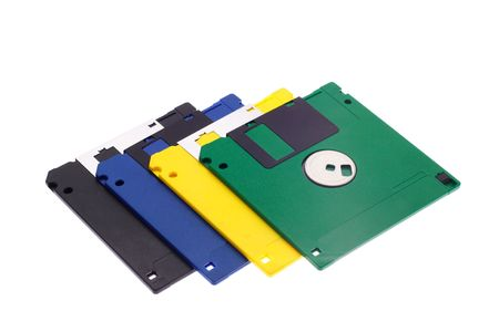The hand holds some multi-coloured diskettes on a white background photo