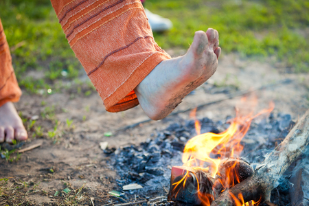 coals: The men bare foot comes in the burning fire