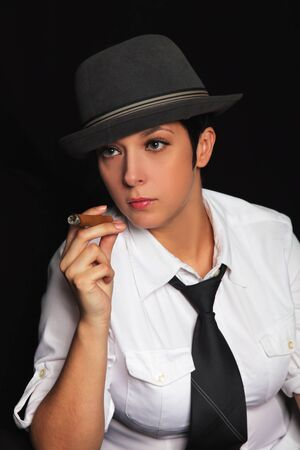 the girl in a hat and a white shirt keeps in fingers a cigar