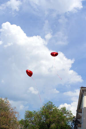 two balls are flying in the sky