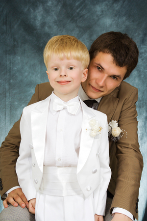 The man and young boy in suits