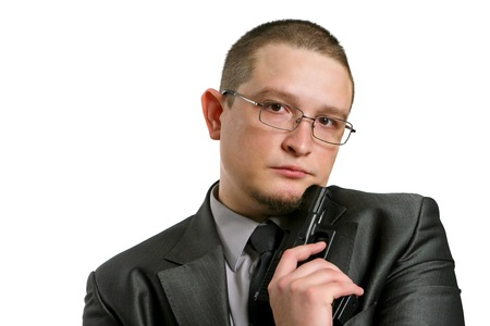 wearing spectacles: the man wearing spectacles and with the gun Stock Photo