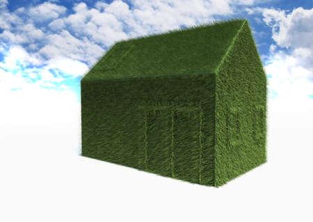 Green Eco House on blue sky photo