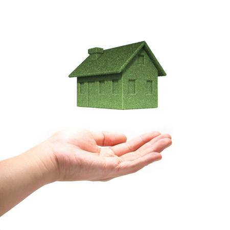 Green Eco house concept  with hand Foto de archivo