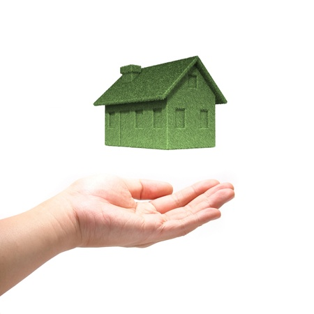 hands holding tree: Green Eco house concept  with hand Stock Photo
