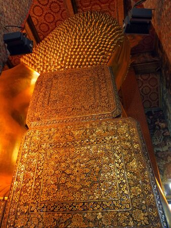The Back of Reclining Buddha, Wat Pho, Bangkok, Thailand photo
