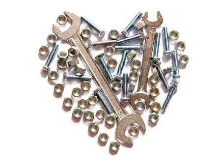 tornillo: surtido de llaves, tuercas y tornillos coraz�n Foto de archivo