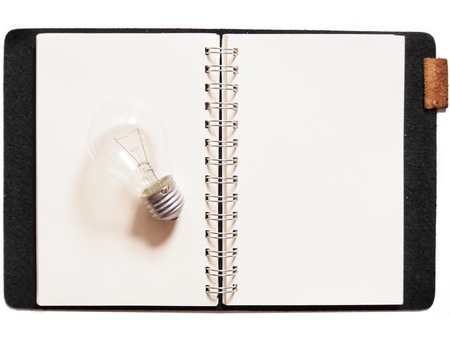 Light bulb placed on notebook  photo