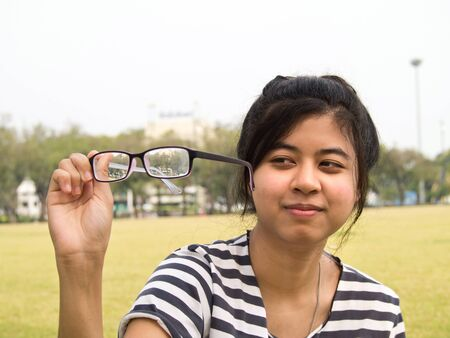 dirtiness: girl trying her glasses and checking out their dirtiness
