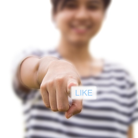 Woman pressing like button photo
