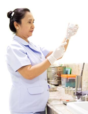 nurse holding syringe on white background. Stock Photo - 13228286