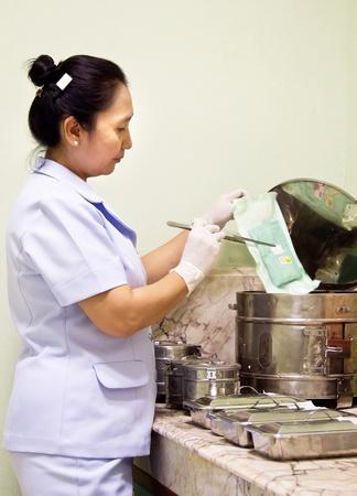 nurse sterilize medical instruments Stock Photo - 13228304