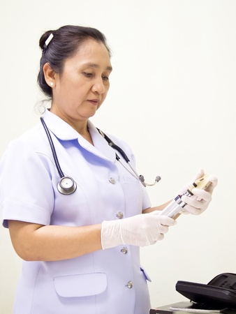 nurse holding syringe on white background. photo