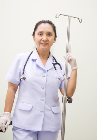 Nurse with I.V drips Equipment Stock Photo - 13228290