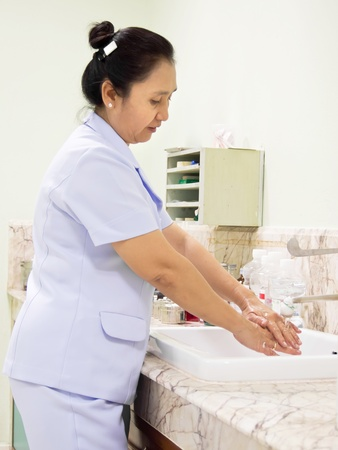 Medical cleanup - Female nurse washing her hands  photo