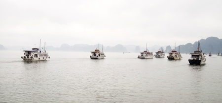 Tourist boats in Halong Bay, Vietnam.  photo