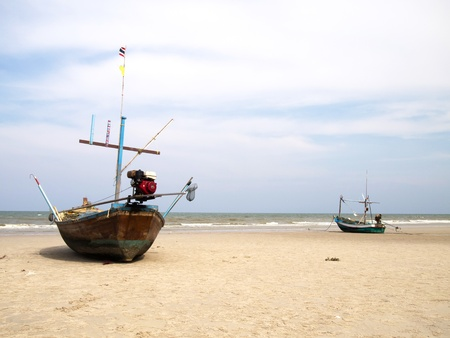 Boats on the beach, huahin, thailand photo