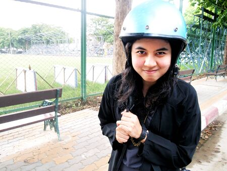 girl is wearing helmet at soccer field. photo