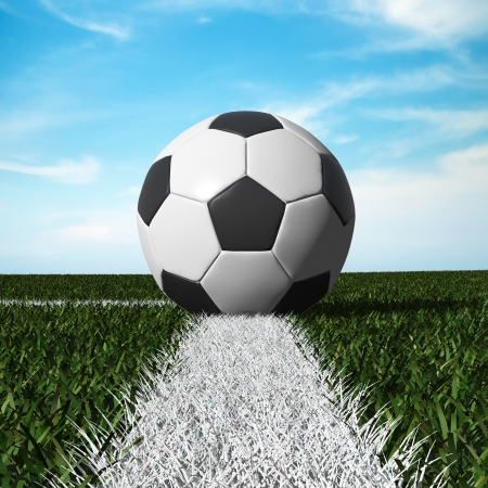 Close up of soccer ball on the field with blue sky