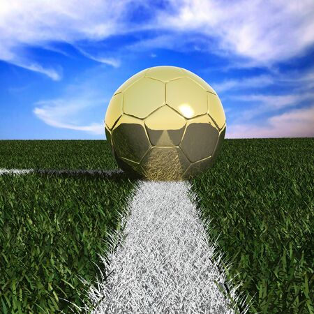 Golden soccer ball in the grass against the sky  photo