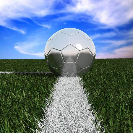 Silver soccer ball in the grass isolated on against the sky  photo