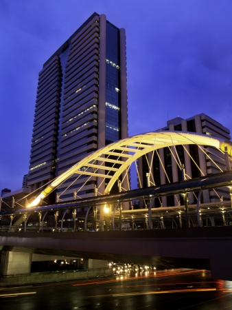 Pubic skywalk with modern buildings of Bangkok downtown square in business zone  photo