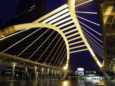 pubic skywalk at bangkok downtown square night in business zone  photo