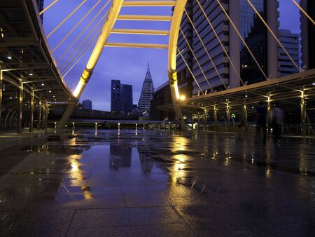pubic skywalk at bangkok downtown square raining day photo