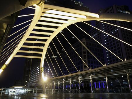 pubic skywalk at bangkok downtown square night, thailand photo