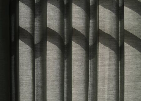 Shade on Grey Curtain, Sunlight Through a Window  photo