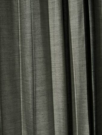 Background of grey illuminated curtain  Stock Photo - 14414343