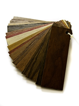 Sample pack of wooden flooring laminate isolated on white background photo