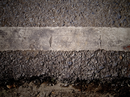 grungy, dirty view of asphalt with distinct white stripe Stock Photo - 15494765