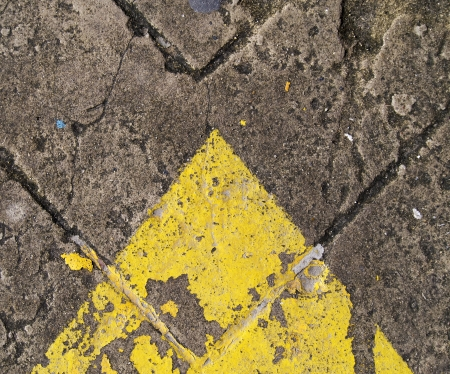 forwarded yellow arrow on the road  photo
