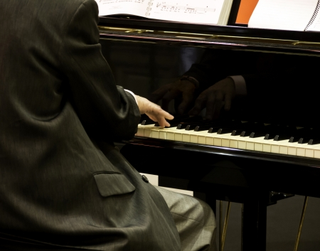 Close up of male hands playing piano. Stock Photo - 15401086