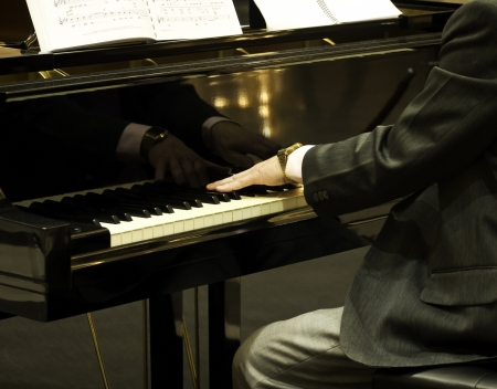Pianist playing the grand piano photo