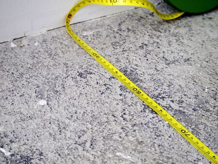 Construction Measuring Tape on Concrete Background  photo