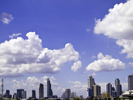 Blue sky with cloud, a city with tall buildings, Bangkok, Thailand Stock Photo - 16025153