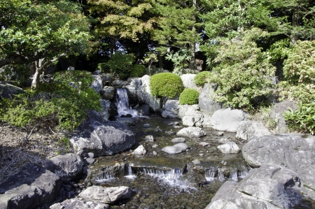 garden with pond in asian style, kyoto, japan photo