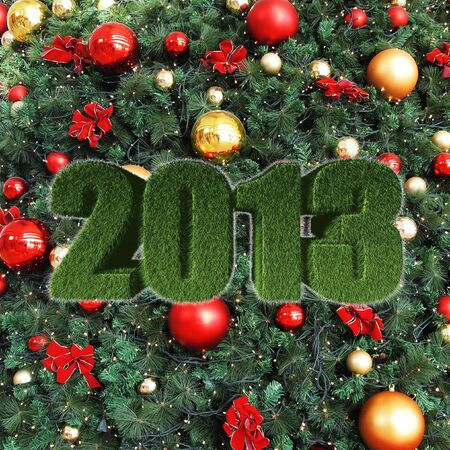 2013 New Year sign on christmas tree decorations photo